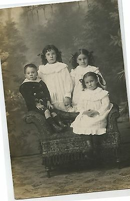 Old RPPC Real Photo Postcard 4 Children Standing in Fancy Chair
