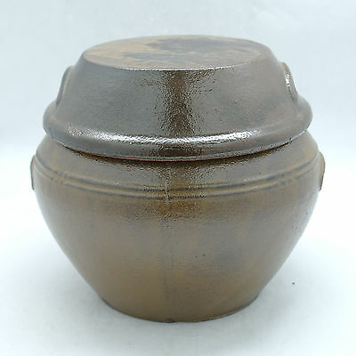 Korean traditional earthenware jar Brown pot with a crude lid