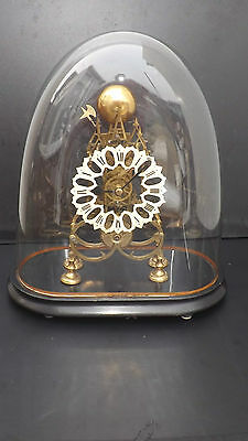 Skeleton Clock Victorian comes with original glass dome and pendulum.