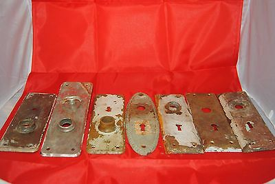 Seven vintage door knob back plates sold as one lot