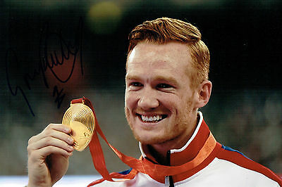 Greg RUTHERFORD Autograph Signed 12x8 Photo AFTAL COA Olympic Gold Medal Winner