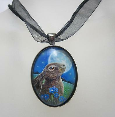 Moon Gazing Hare glass cabochon necklace by Lisa Parker with licensed gift bag