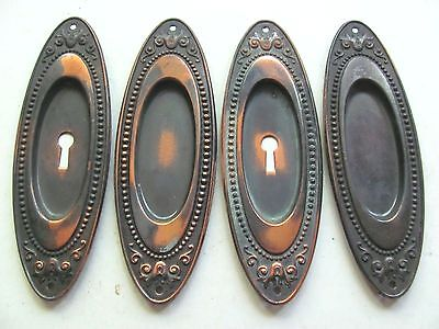 Set of Four Antique Japanned Oval Pocket Door Pulls
