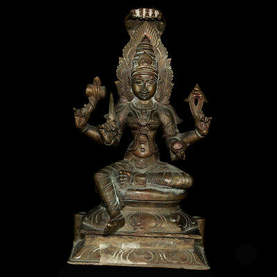 A bronze statue of Durgha surmounted by a five headed naga, 19th C, y251
