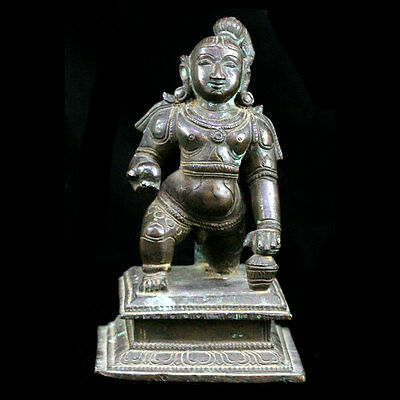 A finely cast bronze baby Krishna holding butter ball 19th C, x5807