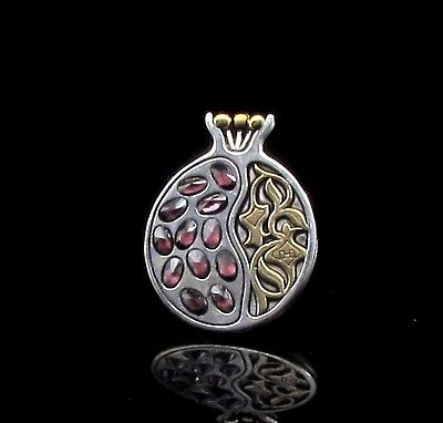 A Silver Pomegranate Pendant With Amethyst
