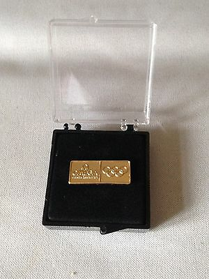 Omega Official Olympic Gold Plated Pin Badge