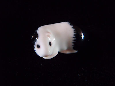 Miniature black and white pottery guinea pig