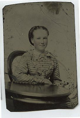 Antique Tintype Photo Young girl Sitting at Table