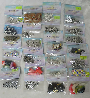 25 packets of charms and decorative beads