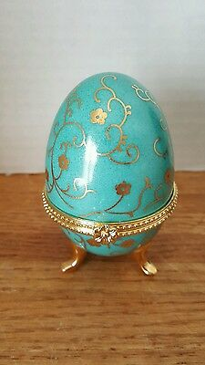 Porcelain egg. Turquoise  in color. Original box.New.