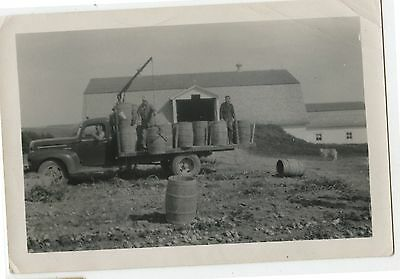 Old Vintage B/W Photo Men Unloading Potato Barrells from Truck