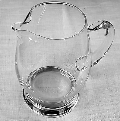 Heavy glass pitcher by Baldwin with sterling silver base B-1