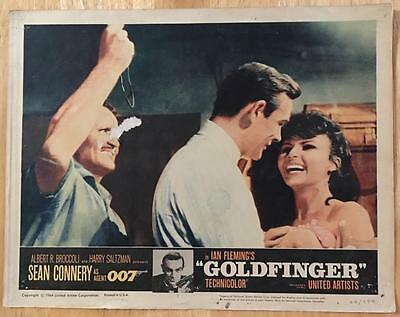 Sean Connery as 007 James Bond is about to be hit Goldfinger 1964 lobby card 164