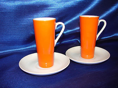 "Pair of Midcentury Orange 4"" Tall, Thin Tea/Coffee Cup on Unmarked White Saucers"
