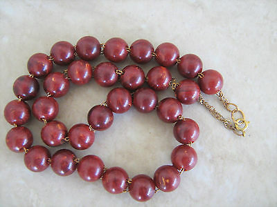 Vintage marbled burgundy Bakelite double hole chain necklace