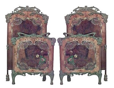 Pair of French Art Nouveau iron single beds with green patina and decorated tole