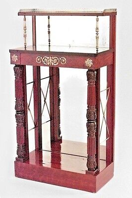English Regency style narrow mahogany mirrored back etagere with black marble to