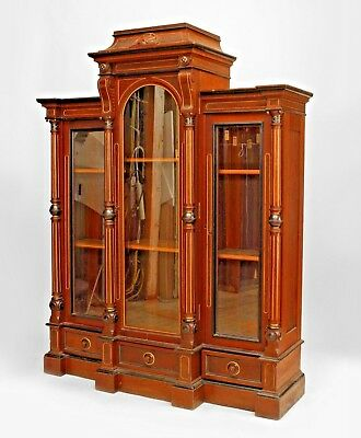 American Victorian Eastlake walnut bookcase with column sides and 3 glass doors