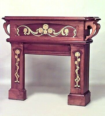 French Art Nouveau walnut fireplace mantel  with bronze floral trim and scroll c