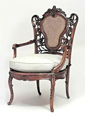 French Art Nouveau walnut arm chair with carved floral filigree cane panel back