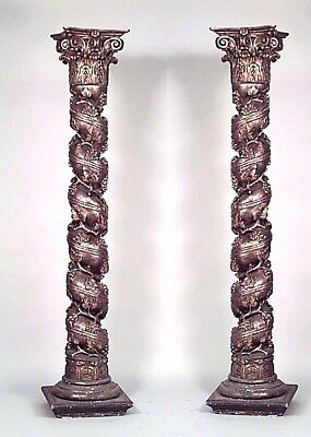 Pair of Italian Rococo style (18/19th Cent) gilt swirl columns with grape and fl