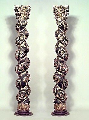 Pair of Italian Baroque style painted black swirl columns with gilt trim and flo
