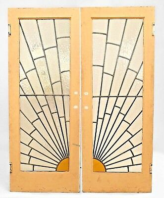 Pair of French Art Deco leaded glass doors with sunburst design and painted fram