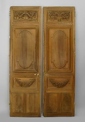Pair of French Victorian Stripped Doors with Carved Top and Wreath Design