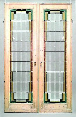 Pair of American Mission stripped pine framed doors with clear and colored leade