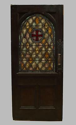 English Gothic style stained-oak door with leaded glass panels and diamond desig