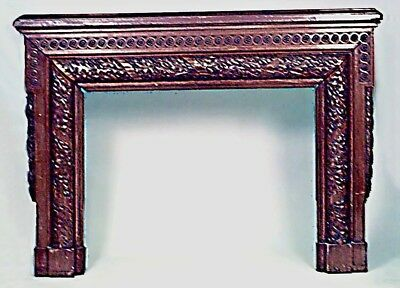 American Victorian carved walnut fireplace mantel surround with acorn and leaf d