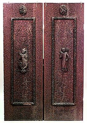 Pair of Asian Burmese style (19th Cent) walnut carved door panels with figures a