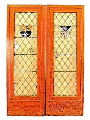 Pair of American Victorian large golden oak framed doors with leaded glass crest