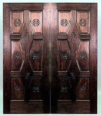 Pair of French Louis XVI style (19th Cent) walnut double sided panelled doors wi