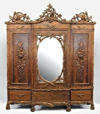 Rustic Black Forest (19th Cent) walnut 3 section armoire cabinet with carved tri