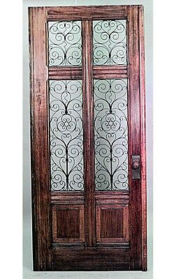 Italian Renaissance style (19th Cent) large oak door with 4 copper filigree gril