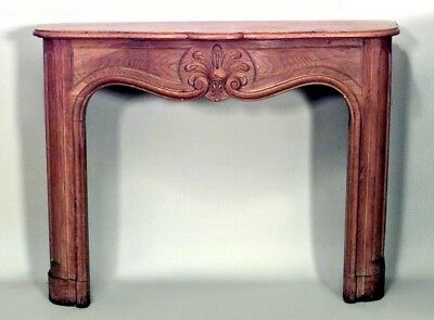 French Provincial style stripped oak fireplace mantel with carved shell center (