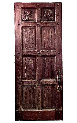 English Renaissance style (19/20th Cent) large provincial oak door with carved h