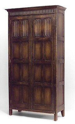 English Renaissance style (19th Cent) stained oak 2 door armoire cabinet with li