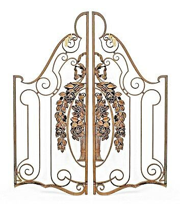 Pair of French Art Deco wrought iron and gilt trimmed gates with ribbon and flor