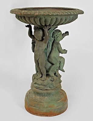 Outdoor Continental style painted iron fountain with triple cupid and dolphin ba