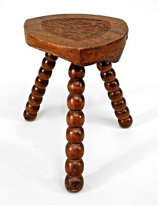 5 English Renaissance style (19/20th Cent) walnut stools with 3 spool legs and t