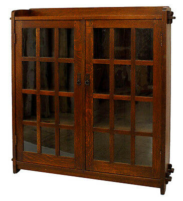 American Mission oak bookcase with rectangular galleried top above 2 glass-panel