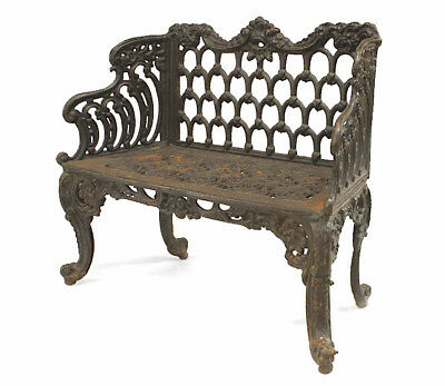 English Victorian black painted cast iron loveseat with scroll design and filigr