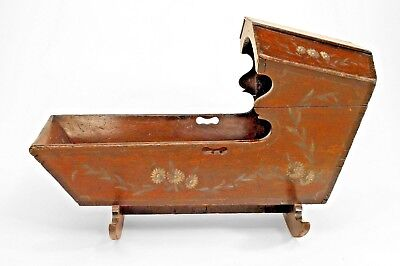 American Country style (19th Cent) stained pine rocking cradle with floral-decor