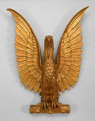American Country style (20th Cent) gilt carved eagle wall plaque with wings spre