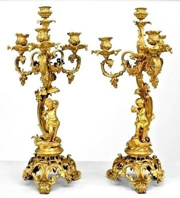 Pair of French Louis XV Style (19th Cent) Bronze Dore Cupid Design Candelabra