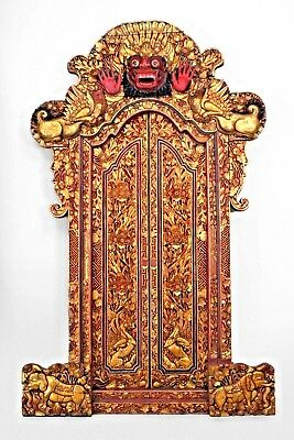 Asian Javanese (18/19th Cent) red and gilt carved temple doors with a large pedi