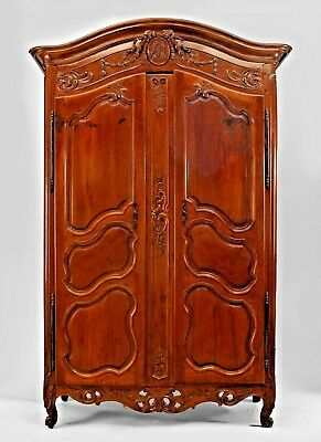French Provincial (18th Cent) walnut carved 2 door armoire with center oval meda